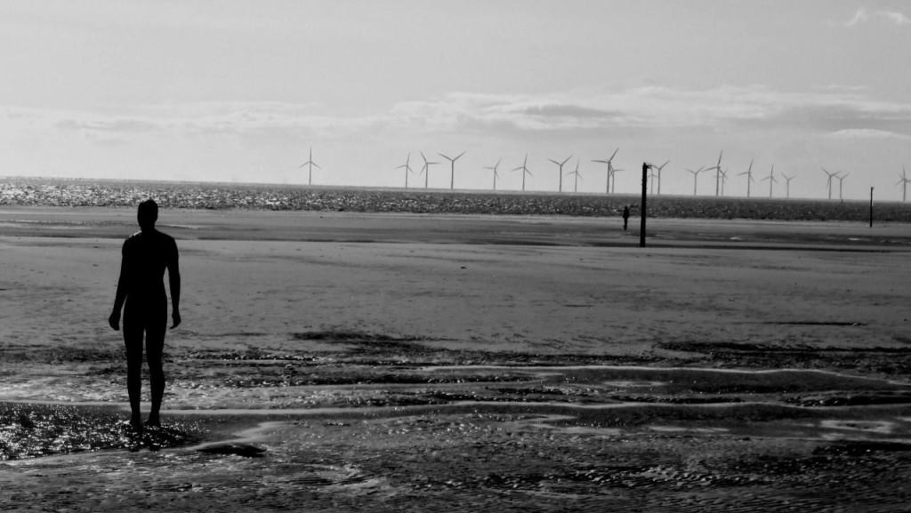 An iron man & turbines on Crosby Beach, Merseyside