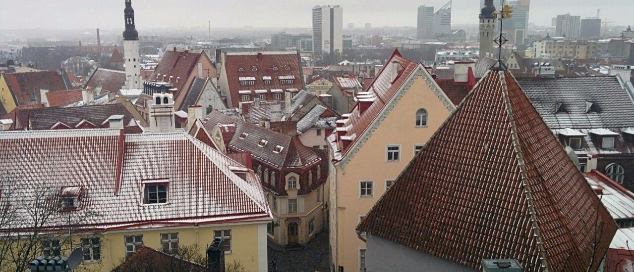 Light snow falls on the rooftops of Tallinn, Estonia