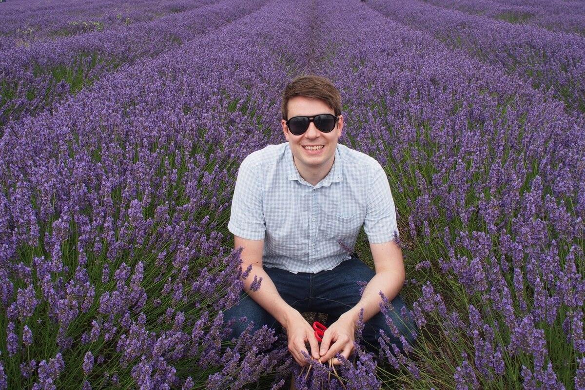 Matt crouches amidst the lavender at Hitchin Lavender