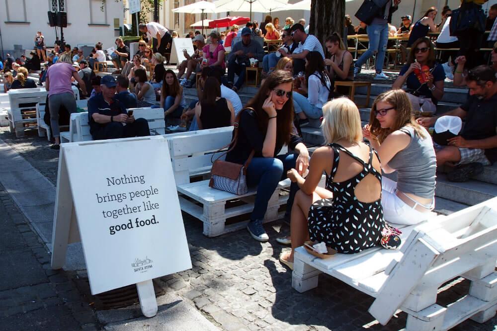 Chatting with friends at Open Kitchen Ljubljana
