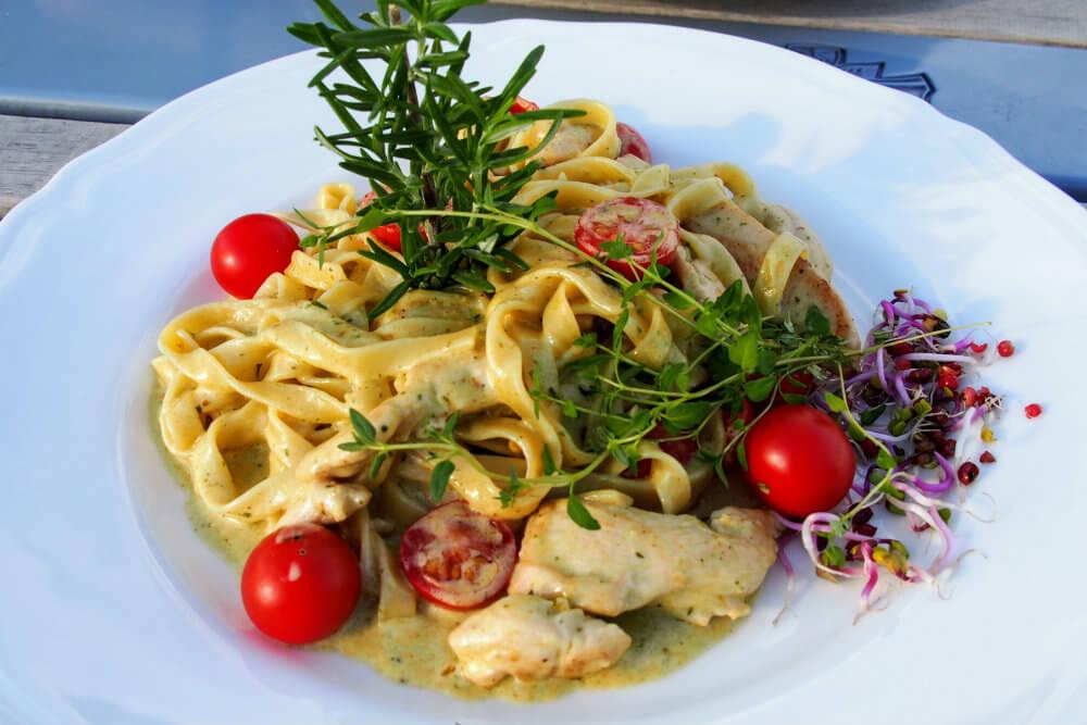 A wholesome pasta dish at Hotel Kolegiacki, Poznań