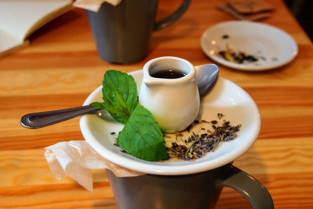 A pot of lavender syrup sits atop a cup of lavender tea at Lavanda