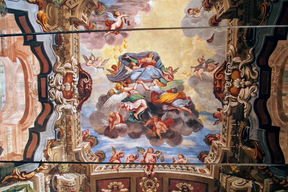 17th century frescoes adorn the ceiling of Chiesa di San Rocco