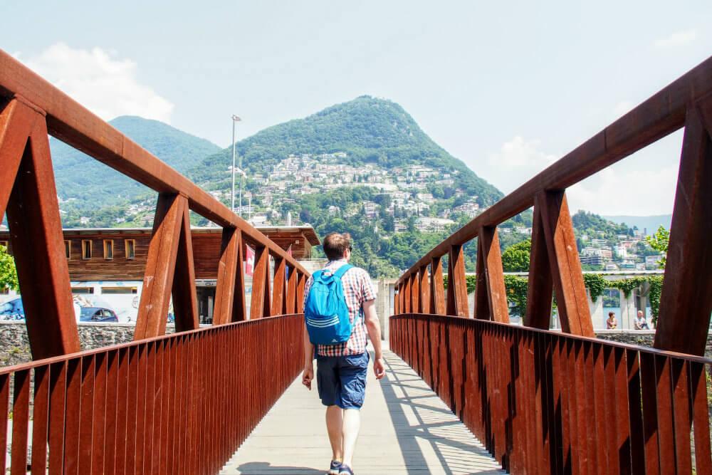 Matt wander across a bridge in search of Lido di Lugano