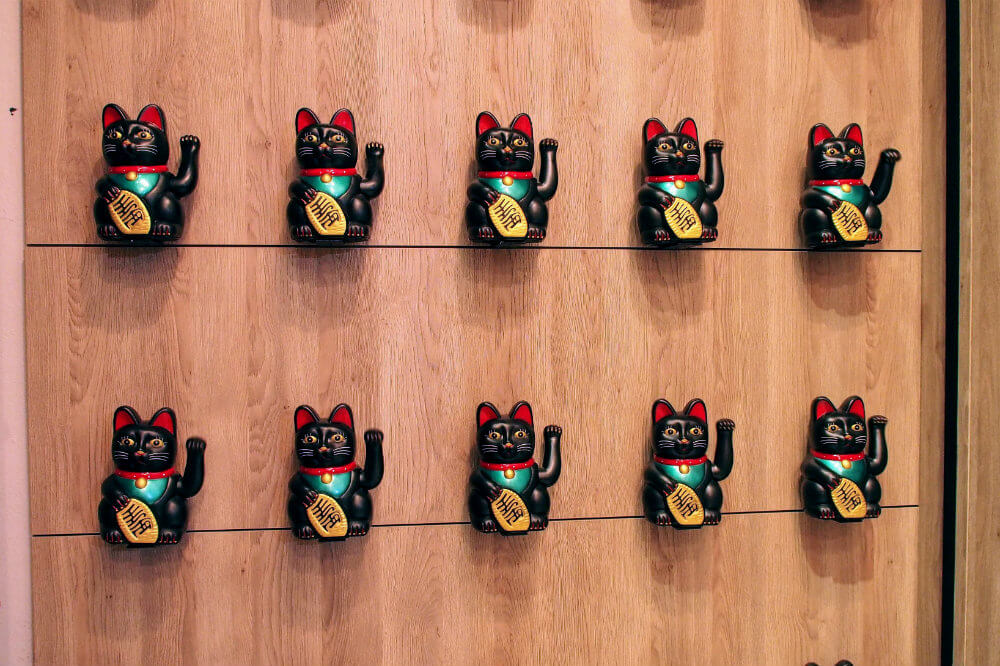 A wall of lucky cats greet patrons at Foodstock, Bratislava