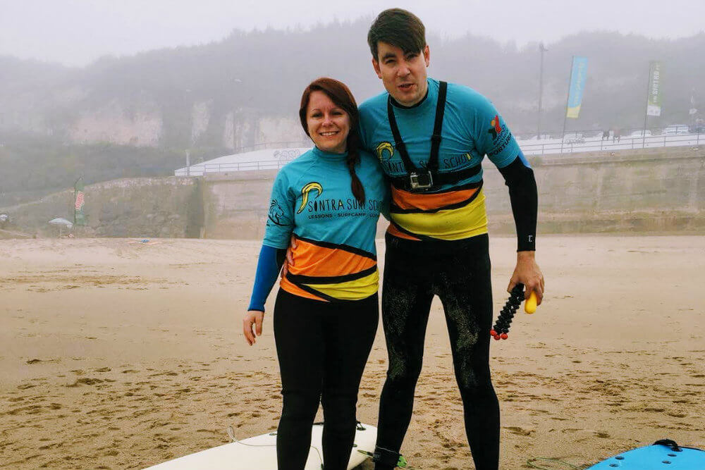 Jade and I, kitted out and ready to surf the waves of the Atlantic Ocean