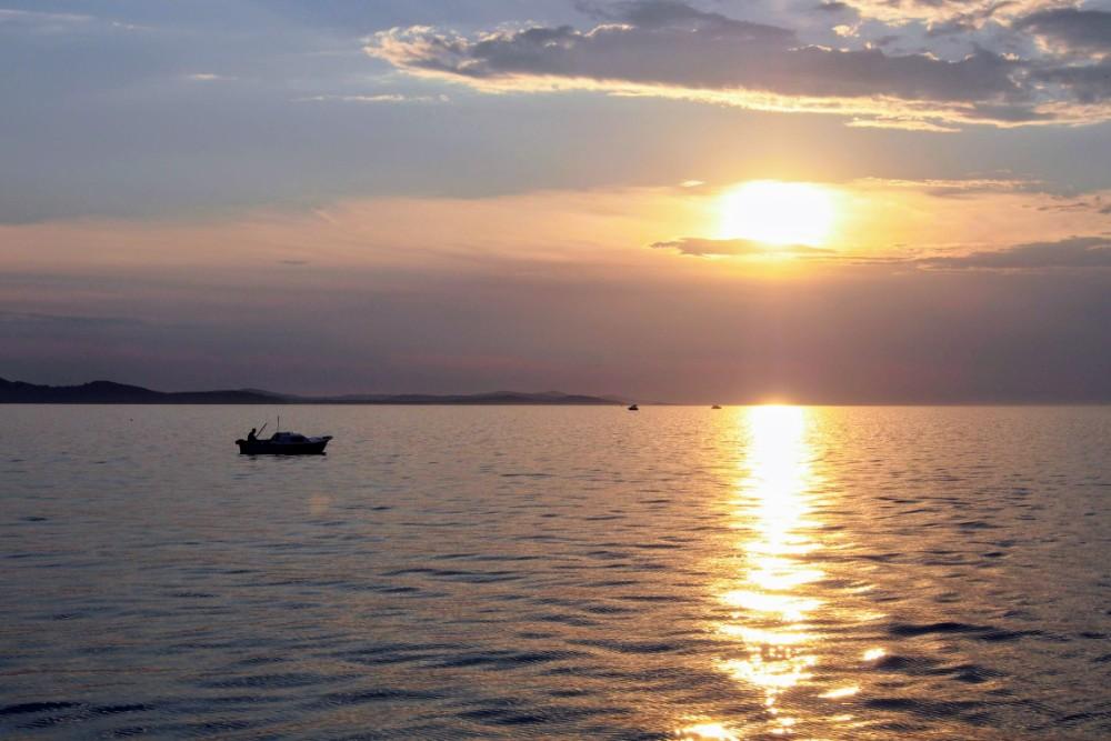 The sun sinks quickly towards the horizon