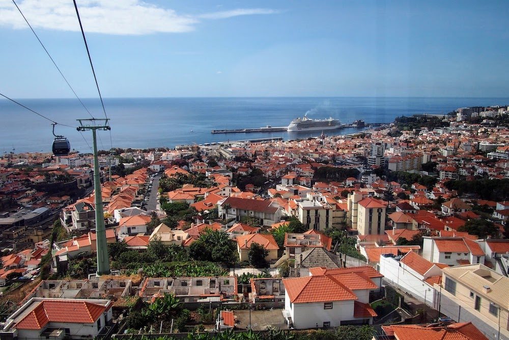 A cruise ship waits patiently in port as its passengers explore Funchal