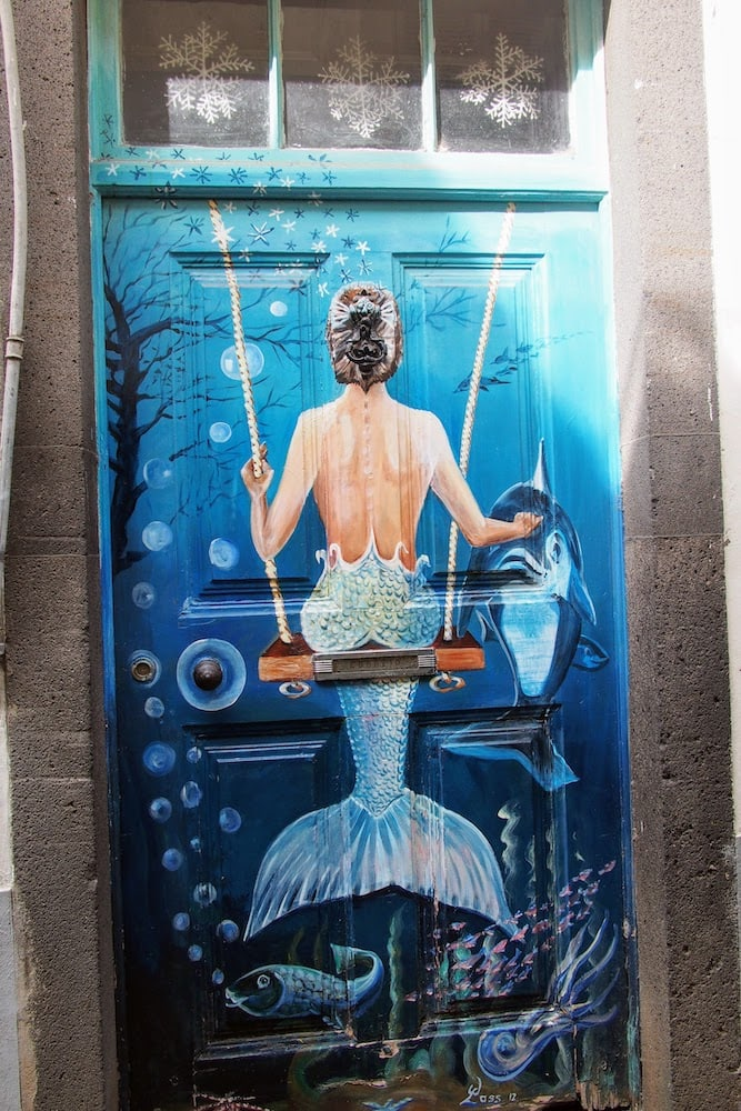 A mermaid painted into a door along Rua de Santa Maria, Funchal
