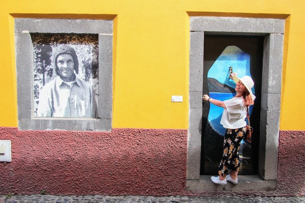 Jade poses next to one of the painted doors along Rua de Santa Maria