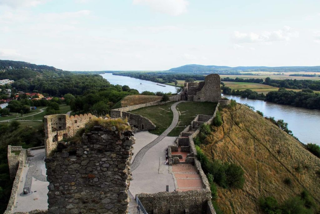 The castle is perched on a cliff at the confluence of the Danube and Morava rivers