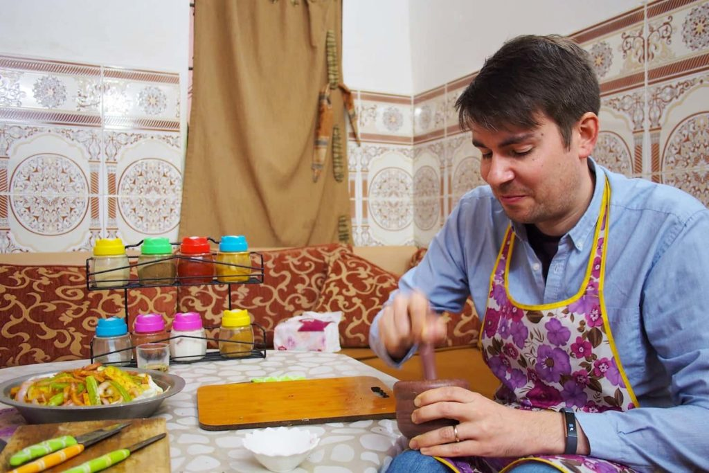 Matt uses a pestle and motor to grind down some whole spices