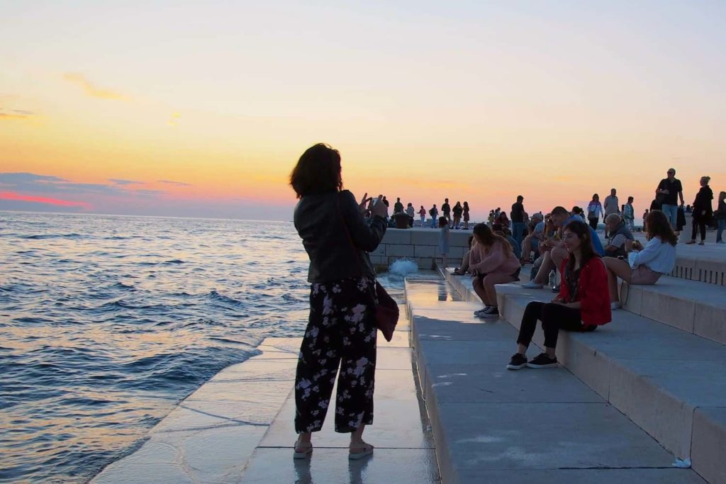People gather on the steps of the Sea Organ, awaiting the sunset spectacular