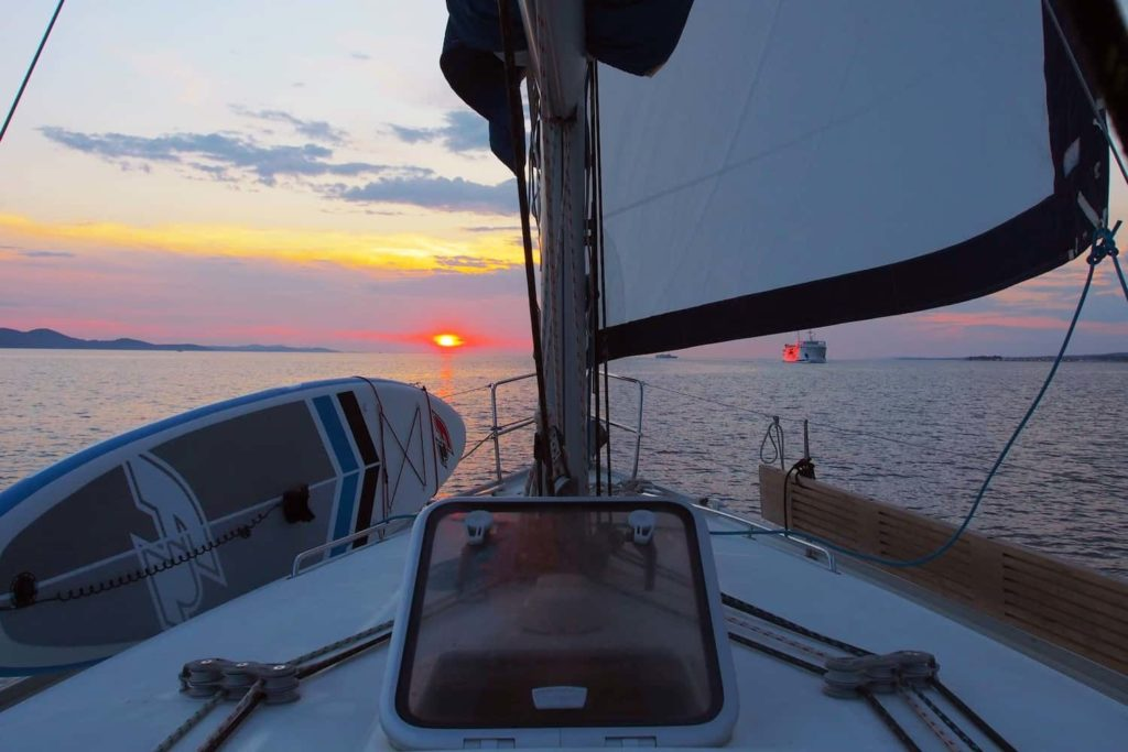 Aboard our vessel for the evening, the sun paints the sky orange