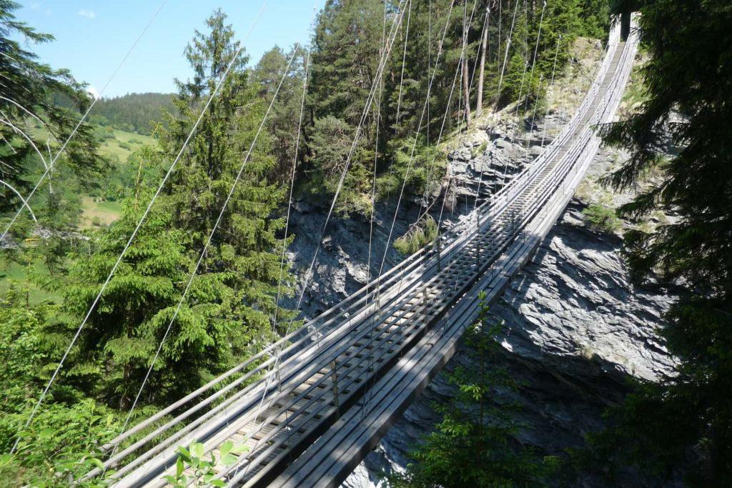 A suspended footbridge above the Viamala Gorge